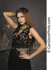 Elegant woman with blonde hair dressed in lace dress