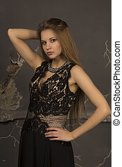Nice woman with blonde hair dressed in lace dress