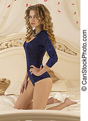 Attractive woman sitting on the bed
