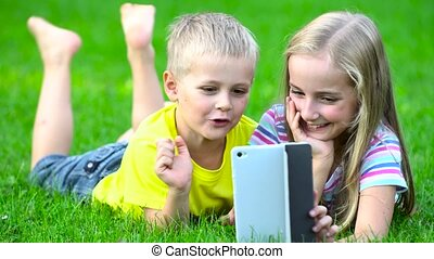 children with smart phone ooutside - children plaing with...