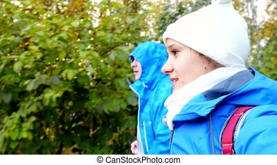 Young couple walking in the autumn park. - Young couple...