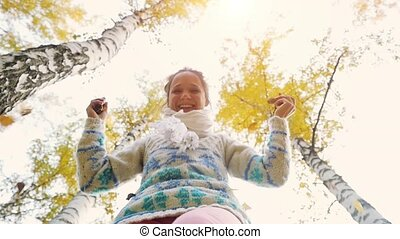 Happy woman wears knitted sweater in autumn park. Joyful and...