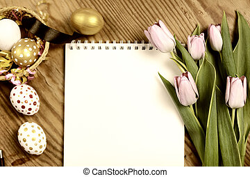 Toned background easter tulips and eggs - colorful painted...