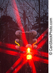 red signal of traffic light in winter
