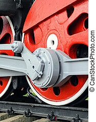 Red big loco wheels - Locomotive side view. Close-up shoot...