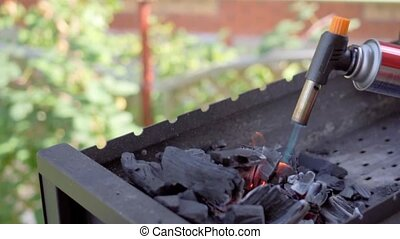 Burning wood in a brazier. Fire, flames. Grill or barbecue....