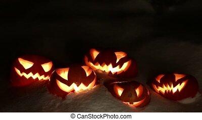 Halloween pumpkins having fun, loop - Five pumpkins glowing...