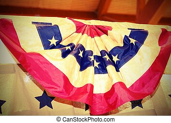 Circular American flag in great shape rosette hanging on the...