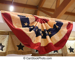 American flag hanging inside the industrial warehouse -...