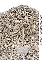 shovel with stone pile