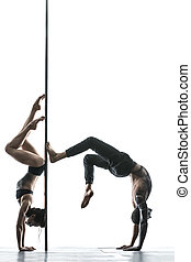 Posing of pole dance couple in studio - Athletic couple of...
