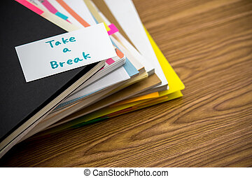 Take a Break; The Pile of Business Documents on the Desk