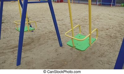 swing swaying in the wind playground childhood - swing...