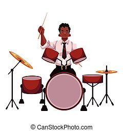 Handsome African male drummer playing drums