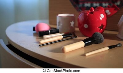 Makeup and brushes on dressing table with Christmas...