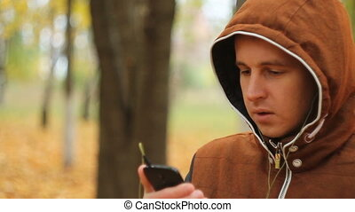 Young man listening to music on smartphone