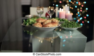 Woman serving bowl of salad on Christmas table - Close up...