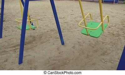 swaying swing in the wind playground childhood - swaying...