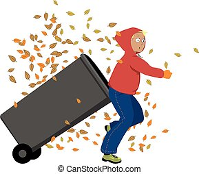 Doing chores - Teenage boy rolling our a garbage bin, autumn...