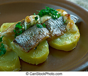 Estonian Baked Herring with Potatoes. Baltic cuisine