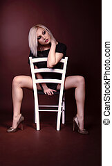Sensual woman sitting on a chair