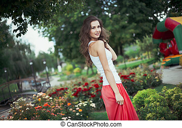 young happy woman in the park