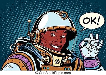 African American astronaut OK gesture, pop art retro vector...