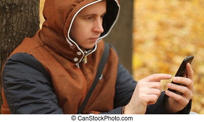 Young man playing game on smartphone
