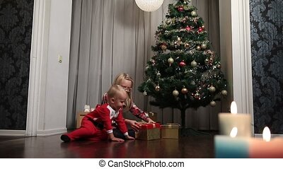 Happy children opening Christmas gift boxes