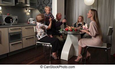 Happy family enjoying Thanksgiving Meal at the table - Happy...