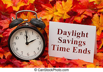 Daylight Savings Time Ends, Some fall leaves, black and...