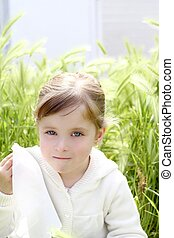 sad little girl crying outdoor green meadow field cereal...