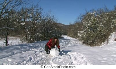 Girl Sculpt Snowman - girl rolling snow ball for snowman