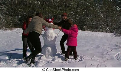 Family Playing in Winter Snow