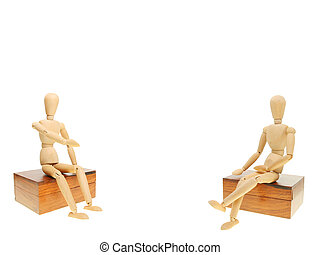 Two mannequins - Two artist\'s mannequins sitting on wooden...