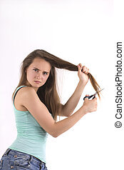 young woman is holding scissors - Beautiful young woman is...