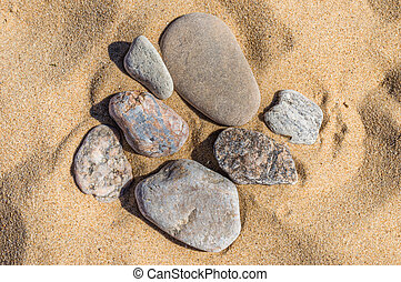 Sand and stone pebbles - pebbles on the sand of various...