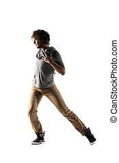 Young street style dancer posing on studio background -...