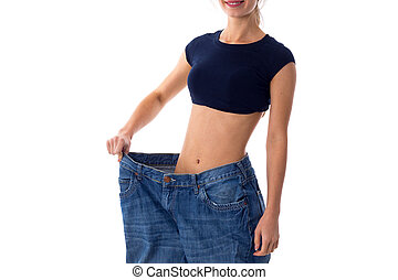 Woman wearing jeans of much bigger size - Woman wearing in...