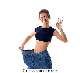 Woman wearing jeans of much bigger size - Young positive...