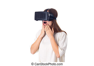 Woman using VR glasses - Young beautiful woman in white...