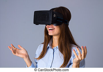 Woman using VR glasses - Young happy woman in blue shirt...