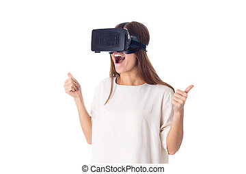 Woman using VR glasses - Young attractive woman in white...