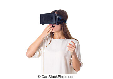 Woman using VR glasses - Young surprised woman in white...