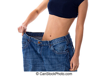 Woman wearing jeans of much bigger size - Thin woman wearing...