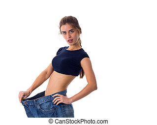 Woman wearing jeans of much bigger size - Young pretty woman...