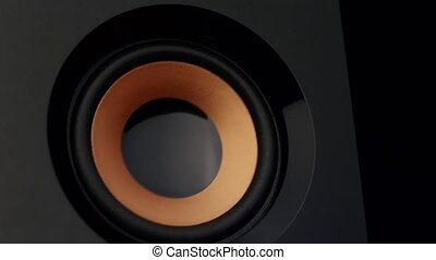 Moving sub-woofer. Closeup - Moving sub-woofer, speaker...