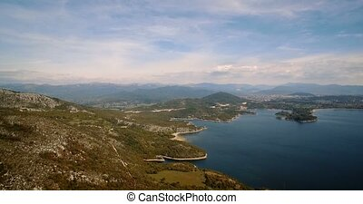 Aerial, Flying Around Jezero Krupac Lake, Montenegro -...
