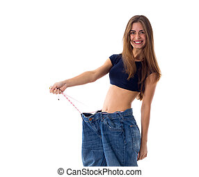 Woman wearing jeans of much bigger size - Smiling young...