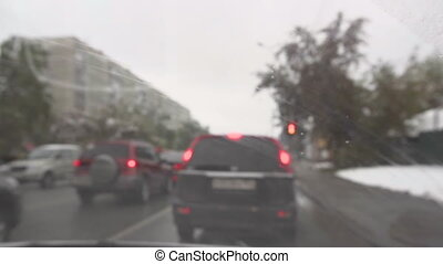 In urban road on a cloudy autumn snowy day - Cars on the...
